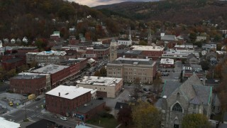 DX0002_220_013 - 5.7K stock footage aerial video of a stationary view of city hall and brick buildings at sunset, Montpelier, Vermont