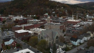 DX0002_220_014 - 5.7K stock footage aerial video of circling city hall and flying away from brick buildings at sunset, Montpelier, Vermont