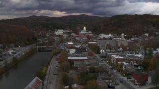 DX0002_220_021 - 5.7K stock footage aerial video focus on the state capitol at sunset while flying by the river, Montpelier, Vermont