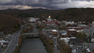 DX0002_220_022 - 5.7K stock footage aerial video of the state capitol at sunset while following the river, Montpelier, Vermont