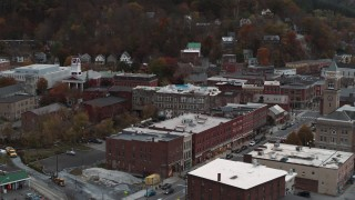 DX0002_220_030 - 5.7K stock footage aerial video of Union Block buildings near city hall at sunset, Montpelier, Vermont
