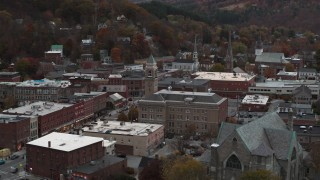 DX0002_220_032 - 5.7K stock footage aerial video of flying by city hall at sunset, reveal church, Montpelier, Vermont