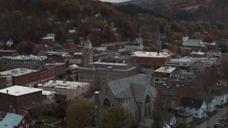 DX0002_220_033 - 5.7K stock footage aerial video of passing by a church and city hall at sunset, Montpelier, Vermont