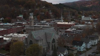 DX0002_220_034 - 5.7K stock footage aerial video of descend and flyby church and city hall at sunset, Montpelier, Vermont