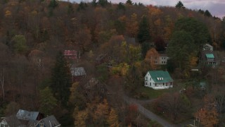 DX0002_220_040 - 5.7K stock footage aerial video of circling homes on a hill at sunset, Montpelier, Vermont