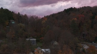 DX0002_220_044 - 5.7K stock footage aerial video of hills with colorful trees at sunset, seen during descent, Montpelier, Vermont