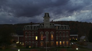 DX0002_220_049 - 5.7K stock footage aerial video focus on the Vermont College of Fine Arts while ascending at twilight, Montpelier, Vermont