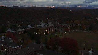 DX0002_220_051 - 5.7K stock footage aerial video ascend and approach the Vermont College of Fine Arts at twilight, Montpelier, Vermont