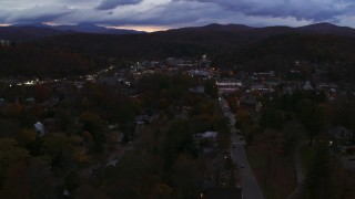 DX0002_220_055 - 5.7K stock footage aerial video of the downtown area of the city seen while passing State Street at twilight, Montpelier, Vermont