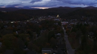 DX0002_220_056 - 5.7K stock footage aerial video of the downtown area of the city seen while flying by State Street at twilight, Montpelier, Vermont