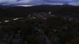 DX0002_220_057 - 5.7K stock footage aerial video of the downtown area of the city seen from homes and State Street at twilight, Montpelier, Vermont
