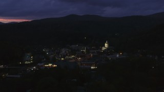 DX0002_220_059 - 5.7K stock footage aerial video of a view of the capitol dome lit up at twilight, Montpelier, Vermont