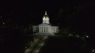 DX0002_221_004 - 5.7K stock footage aerial video of a reverse view of the Vermont State Capitol at night, Montpelier, Vermont