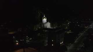 DX0002_221_007 - 5.7K stock footage aerial video of approaching and orbiting the front of the Vermont State Capitol at night, Montpelier, Vermont