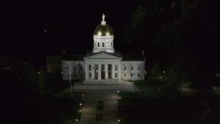 DX0002_221_010 - 5.7K stock footage aerial video of the front of the Vermont State Capitol at night, Montpelier, Vermont