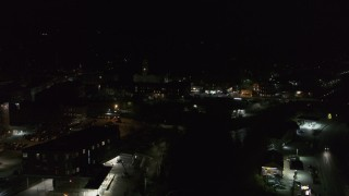 DX0002_221_012 - 5.7K stock footage aerial video of a reverse view of city buildings in downtown at night, Montpelier, Vermont