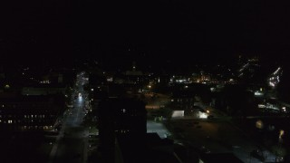 DX0002_221_013 - 5.7K stock footage aerial video of orbiting city buildings in downtown at night, Montpelier, Vermont