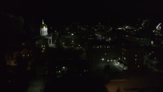 DX0002_221_017 - 5.7K stock footage aerial video of the Vermont State Capitol behind a dark building at night, Montpelier, Vermont