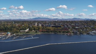 DX0002_222_007 - 5.7K stock footage aerial video of the downtown area seen from Lake Champlain breakwaters, Burlington, Vermont