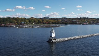 DX0002_222_011 - 5.7K stock footage aerial video orbit a lighthouse on Lake Champlain and reveal a marina, Burlington, Vermont