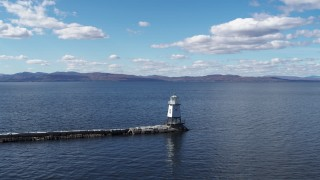 DX0002_222_013 - 5.7K stock footage aerial video orbit and fly away from a lighthouse on Lake Champlain, Burlington, Vermont
