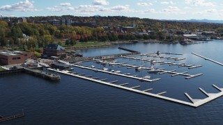 DX0002_222_014 - 5.7K stock footage aerial video fly away from and orbit a marina on Lake Champlain, Burlington, Vermont
