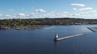 DX0002_222_020 - 5.7K stock footage aerial video of passing a marina on Lake Champlain, reveal lighthouse, Burlington, Vermont