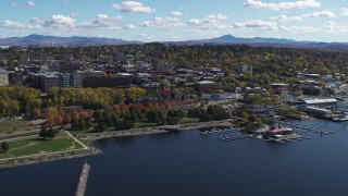 DX0002_222_023 - 5.7K stock footage aerial video of ascending toward downtown from the lake, Burlington, Vermont