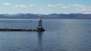 DX0002_222_026 - 5.7K stock footage aerial video flying low toward a lighthouse on Lake Champlain, Burlington, Vermont