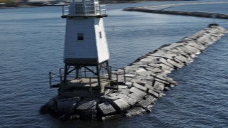 DX0002_222_027 - 5.7K stock footage aerial video closely orbiting a lighthouse on Lake Champlain, Burlington, Vermont