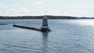 DX0002_222_028 - 5.7K stock footage aerial video low altitude orbit around a lighthouse on Lake Champlain, Burlington, Vermont