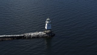 DX0002_222_029 - 5.7K stock footage aerial video of ascending around a lighthouse on Lake Champlain, Burlington, Vermont