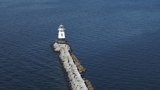 DX0002_222_030 - 5.7K stock footage aerial video circling a lighthouse at the end of a breakwater on Lake Champlain, Burlington, Vermont