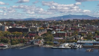 DX0002_222_033 - 5.7K stock footage aerial video descend and flyby city buildings in downtown, Burlington, Vermont