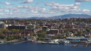 DX0002_222_034 - 5.7K stock footage aerial video slowly flying by city buildings in downtown, Burlington, Vermont