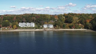 DX0002_223_003 - 5.7K stock footage aerial video orbit condos on the shore of Lake Champlain, Burlington, Vermont