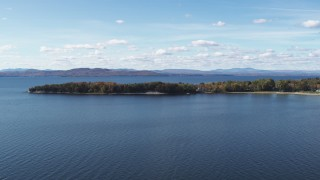 DX0002_223_013 - 5.7K stock footage aerial video of passing by waterfront homes on Appletree Point by Lake Champlain, Burlington, Vermont