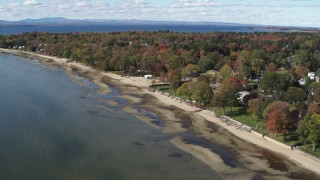 DX0002_223_016 - 5.7K stock footage aerial video of orbiting beachfront homes on the shore of Lake Champlain, Burlington, Vermont