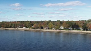 DX0002_223_017 - 5.7K stock footage aerial video orbit beachfront homes on the shore of Lake Champlain, Burlington, Vermont