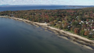 DX0002_223_020 - 5.7K stock footage aerial video of a view of beachfront homes on the shore of Lake Champlain, Burlington, Vermont