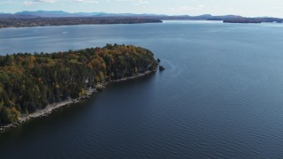 DX0002_223_022 - 5.7K stock footage aerial video of approaching forest on the tip of Lone Rock Point by Lake Champlain, Burlington, Vermont