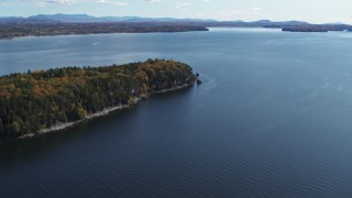 DX0002_223_025 - 5.7K stock footage aerial video of a reverse view of forest on the tip of Lone Rock Point by Lake Champlain, Burlington, Vermont