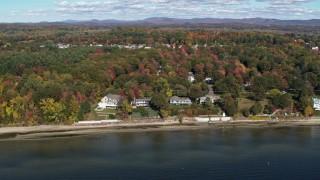 DX0002_223_026 - 5.7K stock footage aerial video orbit four beachfront homes on the shore of Lake Champlain, Burlington, Vermont