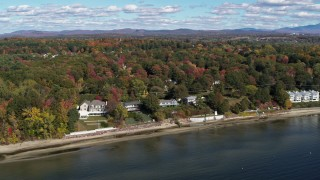 DX0002_223_027 - 5.7K stock footage aerial video of orbiting four beachfront homes on the shore of Lake Champlain, Burlington, Vermont
