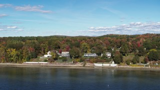 DX0002_223_028 - 5.7K stock footage aerial video of reverse view of four beachfront homes on the shore of Lake Champlain, Burlington, Vermont