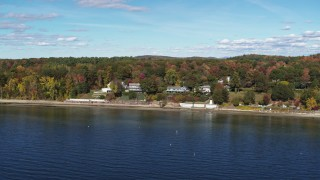 DX0002_223_029 - 5.7K stock footage aerial video of circling four beachfront homes on the shore of Lake Champlain, Burlington, Vermont