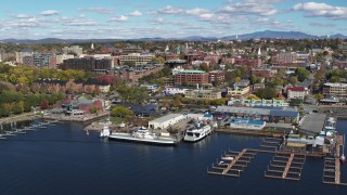 DX0002_224_002 - 5.7K stock footage aerial video of orbiting city buildings and Ferry Dock Marina in downtown, Burlington, Vermont