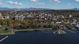 DX0002_224_004 - 5.7K stock footage aerial video of orbiting city buildings, park and marina in downtown, Burlington, Vermont