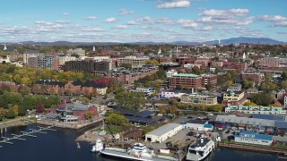 DX0002_224_007 - 5.7K stock footage aerial video orbit downtown buildings and marinas, Burlington, Vermont