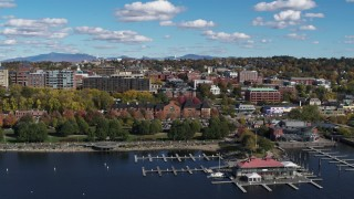 DX0002_224_008 - 5.7K stock footage aerial video of downtown buildings behind a marina and Waterfront Park, Burlington, Vermont